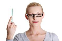 Mujer con el lápiz Foto de archivo