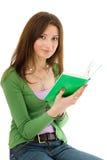 Mujer con el Libro verde Imagen de archivo libre de regalías