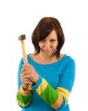 Mujer con el martillo Imagen de archivo