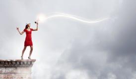 Mujer con el megáfono Fotos de archivo libres de regalías