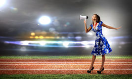 Mujer con el megáfono Imágenes de archivo libres de regalías
