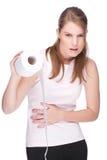 Mujer con el papel higiénico Foto de archivo libre de regalías