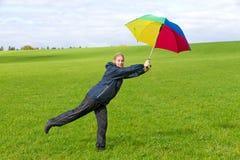 Mujer con el paraguas Foto de archivo libre de regalías