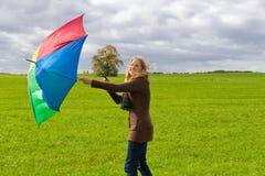 Mujer con el paraguas Fotos de archivo