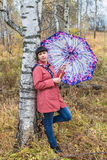 Mujer con el paraguas Imagen de archivo libre de regalías