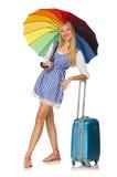 Mujer con el paraguas aislado en blanco Foto de archivo