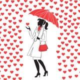 Mujer con el paraguas debajo de la lluvia de corazones rojos Fotografía de archivo libre de regalías