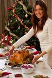 Mujer con el pavo de la Navidad Imagen de archivo libre de regalías