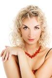 Mujer con el pelo del enrollamiento Fotografía de archivo