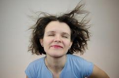 Mujer con el pelo en el viento Fotografía de archivo libre de regalías