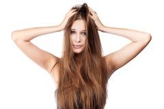 Mujer con el pelo enredado. Fotografía de archivo
