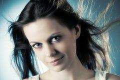 Mujer con el pelo que agita fotografía de archivo libre de regalías