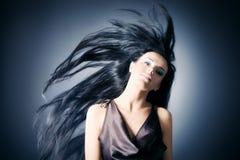 Mujer con el pelo que agita Imágenes de archivo libres de regalías