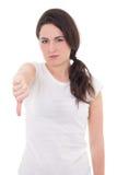 Mujer con el pulgar abajo aislado en el fondo blanco Foto de archivo libre de regalías