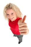 Mujer con el pulgar para arriba Imagen de archivo libre de regalías