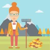 Mujer con el rastrillo que coloca el montón cercano de las hojas de otoño ilustración del vector