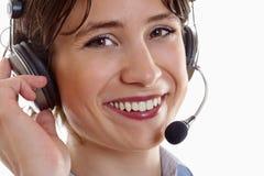 Mujer con el receptor de cabeza imagen de archivo libre de regalías