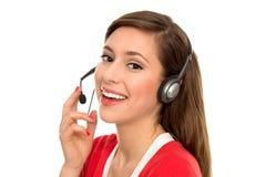 Mujer con el receptor de cabeza del teléfono Imagen de archivo libre de regalías