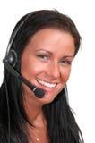 Mujer con el receptor de cabeza del teléfono imágenes de archivo libres de regalías