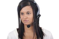 Mujer con el receptor de cabeza y el micrófono que miran lejos Fotografía de archivo