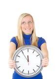 Mujer con el reloj Imágenes de archivo libres de regalías