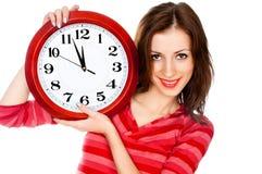 Mujer con el reloj aislado en blanco Foto de archivo libre de regalías