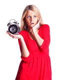 Mujer con el reloj de alarma Foto de archivo