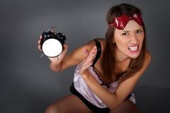 Mujer con el reloj de alarma Imagen de archivo libre de regalías