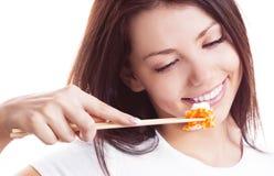 Mujer con el sushi Foto de archivo libre de regalías