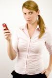 Mujer con el teléfono. Imagenes de archivo