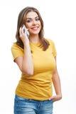 Mujer con el teléfono aislado en blanco Imagen de archivo libre de regalías