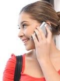 Mujer con el teléfono celular Fotografía de archivo libre de regalías