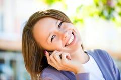 Mujer con el teléfono celular Imagen de archivo libre de regalías