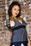 Mujer con el teléfono celular Imágenes de archivo libres de regalías