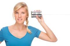 Mujer con el teléfono del estaño fotos de archivo libres de regalías