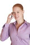 Mujer con el teléfono móvil Fotos de archivo