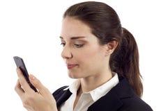 Mujer con el teléfono móvil Fotos de archivo libres de regalías