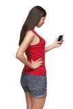 Mujer con el teléfono móvil Fotografía de archivo libre de regalías