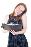 Mujer con el teléfono móvil y el organizador imagen de archivo libre de regalías