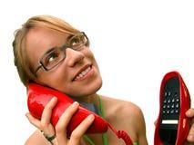 Mujer con el teléfono rojo Imagen de archivo libre de regalías