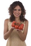 Mujer con el tomate. Fotos de archivo libres de regalías