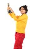 Mujer con el trofeo del oro Imagen de archivo libre de regalías