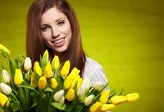 Mujer con el tulipán Foto de archivo