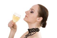 Mujer con el vidrio de vino fotografía de archivo libre de regalías
