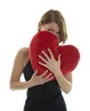 Mujer con la almohadilla del corazón Fotografía de archivo