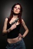 Mujer con la arma de mano Fotografía de archivo