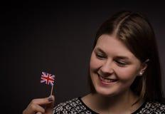 Mujer con la bandera de Gran Bretaña Foto de archivo