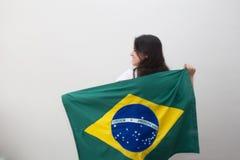 Mujer con la bandera en el fondo blanco Imagen de archivo libre de regalías