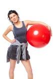 Mujer con la bola de la gimnasia fotografía de archivo