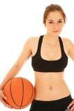 Mujer con la bola del baloncesto Fotografía de archivo